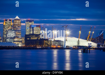 View of London skyline over the River Thames featuring Canary Wharf and O2 Arena, London, England, UK - Stock Photo