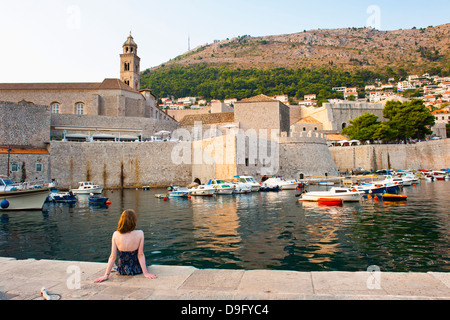 Tourist admiring Dominican Monastery, Dubrovnik Old Town, UNESCO World Heritage Site, Dubrovnik, Dalmatian Coast, - Stock Photo