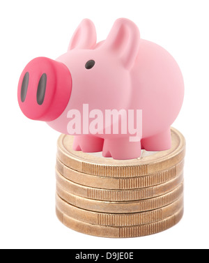 Piggy bank standing on stack of euro coins - Stock Photo