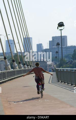 Young cyclist on the Świętokrzyski Bridge, Warsaw, Poland - Stock Photo