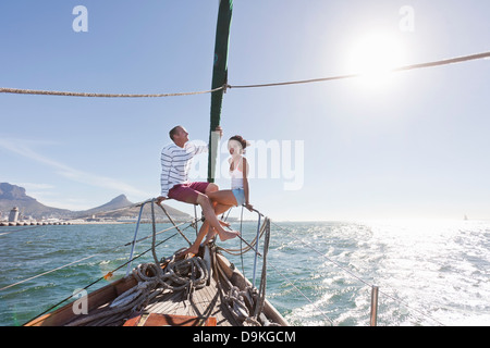 Young couple on deck of yacht - Stock Photo