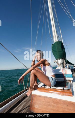 Young woman on deck of yacht - Stock Photo
