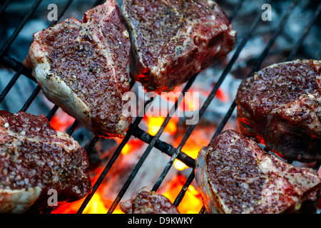 Lamb chops sizzle over a mesquite charcoal fire in Santa Monica, California on 10 August 2008. - Stock Photo