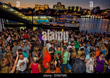 Rave on the Thames beach during the Thames Festival, London, UK - Stock Photo