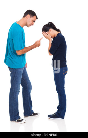 angry man pointing his crying girlfriend isolated on white background - Stock Photo