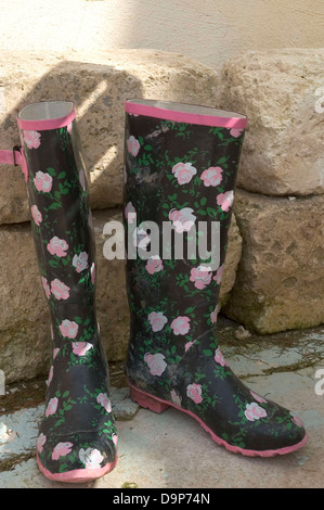 Pair of rubber boots with floral pattern - Stock Photo