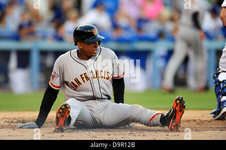 Los Angeles, CA. USA. June 24, 2013. San Francisco Giants third baseman Joaquin Arias #13 slides and is safe at - Stock Photo