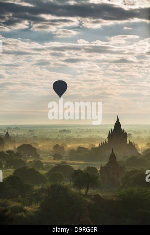 balloons over the Temples of Bagan at dawn, Myanmar (Burma) - Stock Photo