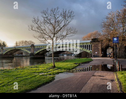 Grade two Listed Richmond Rail bridge and Twickenham Road Bridge across the Thames River - Stock Photo