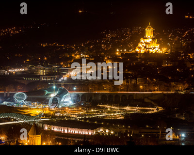 Tbilisi seen from Fort Narikala with the The Holy Trinity Cathedral by night. - Stock Photo