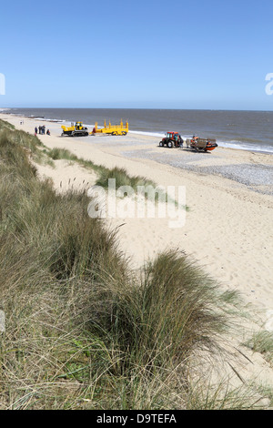 caister lifeboat and launch vehicles on the norfolk coast - Stock Photo