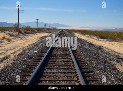 railway tracks in the desert - Stock Photo