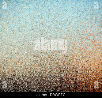 Abstract of stippled glass window pane with ambient colours from outside as background texture - Stock Photo