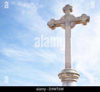 Old Christ cross on sky background - Stock Photo
