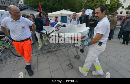 Paramedics tend to participants of a hunger strike in a provisional tent in the center of Munich,Germany, 28June - Stock Photo