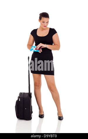 modern young businesswoman waiting for flight and checking time over white background - Stock Photo
