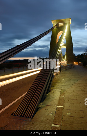 One of the illuminated piers of Clifton Suspension Bridge, Bristol, UK, at dusk. - Stock Photo