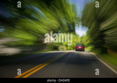 Car Speeding On Road, USA - Stock Photo