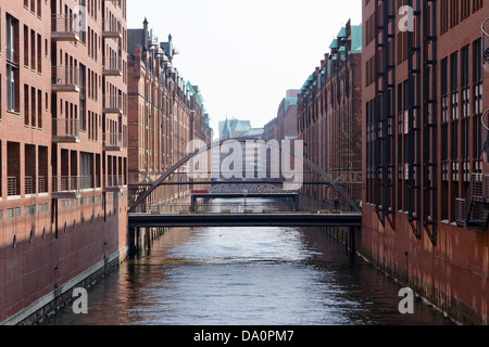 Canal and bridges at the historic Speicherstadt in Haburg, Germany. - Stock Photo