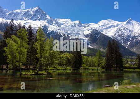 Chamonix Aiguilles, Aiguille du Midi and Mont Blanc from Lac des Gaillands, Chamonix, France - Stock Photo
