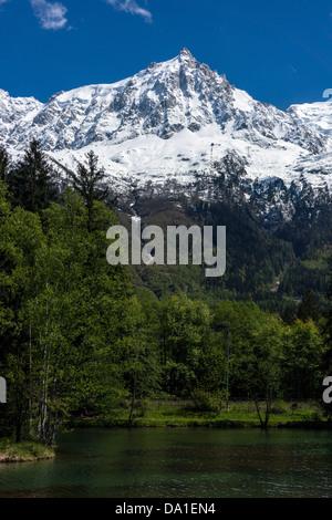 Chamonix Aiguilles and Aiguille du Midi from Lac des Gaillands, Chamonix, France - Stock Photo