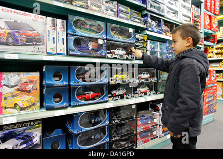7-year-old boy in a toy shop - Stock Photo