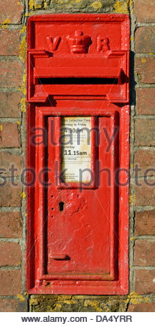 Victorian post box in the wall at Hope Cove, South Devon, England, UK. - Stock Photo