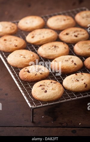 Making homemade almond cookies on wooden table - Stock Photo