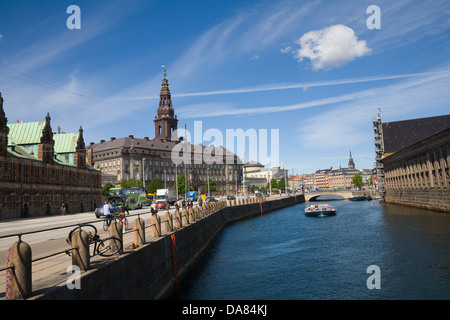 Copenhagen Denmark EU View along canal to Old Stock Exchange Building Borsen and Christiansborg Palace on islet - Stock Photo