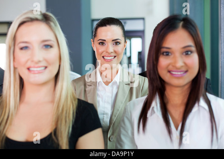 happy businesswoman among group of colleagues - Stock Photo