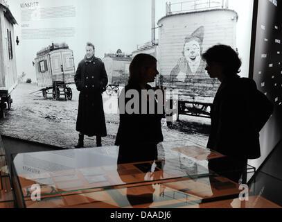 A visitor eyes exhibits in the exhibition 'Ingmar Bergman - Thruth and Lies'at Deutsche Kinemathek film museum - Stock Photo