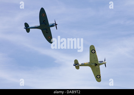 A 1941 Hawker sea Hurricane and a 1942 Spitfire flying in formation, England - Stock Photo