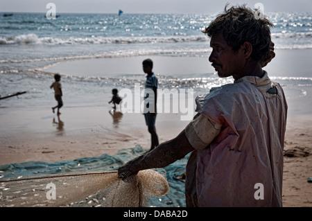 Fisherman on the beach. Puri, Orissa, India - Stock Photo