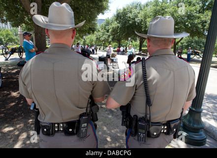 Safety officers monitor crowds at the Texas Capitol as politicians consider  new laws restricting abortions an women - Stock Photo