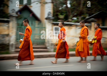 Buddhist Monks during Alms giving ceremony (Tak Bat), Luang Prabang, Laos, Indochina, Southeast Asia, Asia - Stock Photo