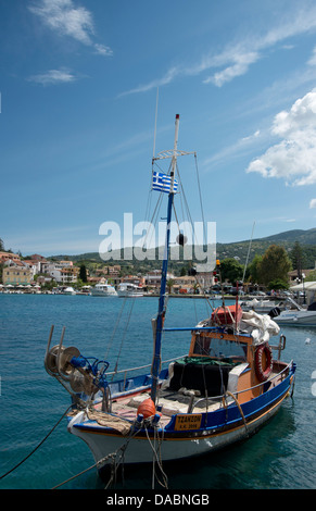 Traditional wooden fishing boat in harbour in Kassiopi on the northeast coast of Corfu, Ionian Islands, Greek Islands, - Stock Photo