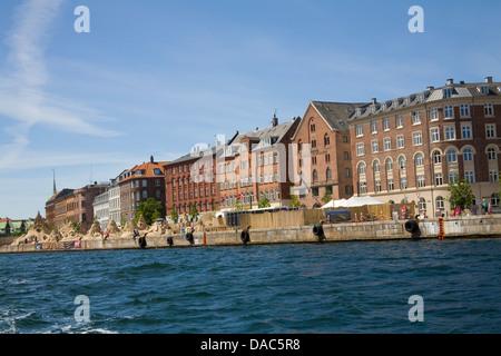 Copenhagen Denmark EU View along historic buildings of Havnegade with sand sculptures from International Festival - Stock Photo
