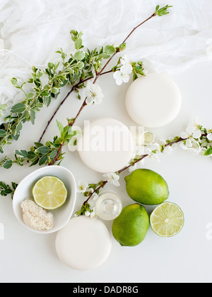 Aromatic still life with soaps, blossom and lime - Stock Photo