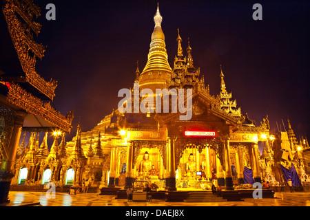 The main ZEDI of the SHWEDAGON PAYA or PAGODA which dates from 1485 is gilded every year, Burma, Yangon - Stock Photo