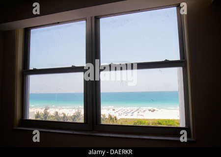 Miami Beach Florida Presidential Condominiums condo window beach view Atlantic Ocean frame - Stock Photo
