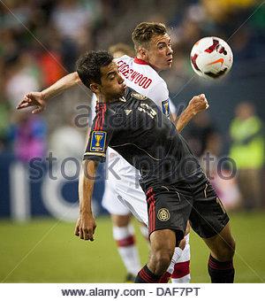 Seattle, Washington, USA. 11th July, 2013. Mexico's ADRIAN ALDRETE (13) and Canada's NIKOLAS LEDGERWOOD (2) battle - Stock Photo