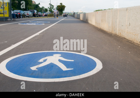 Pedestrian sign on asphalt. Leisure activities - Stock Photo