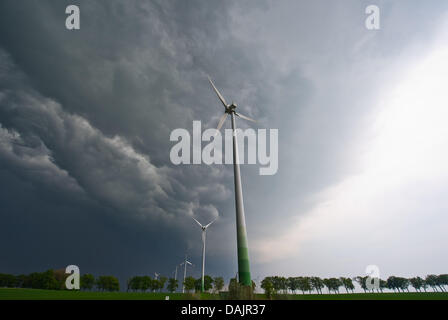 Thunderstorms approaches a field with wind wheels near Sieversdorf, Germany, 26 April 2011. PHOTO: PATRICK PLEUL - Stock Photo