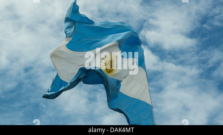 Argentina, Buenos Aires, Argentine flag waving in  wind - Stock Photo