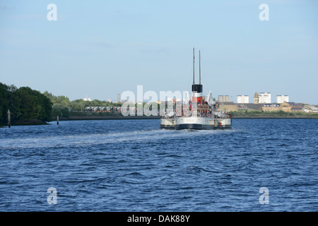 Paddle steamer Waverley cruising up the Clyde at Erskine towards Glasgow. Clydebank in the background. - Stock Photo