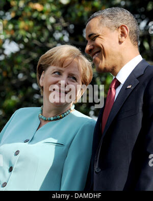 US President Barack Obama receives German Chancellor Angela Merkel with military honours at the White House in Washington - Stock Photo