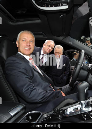 Chairman of the board of Porsche AG, Matthias Mueller (L-R), chairman of the board of Porsche Automobil Holding - Stock Photo