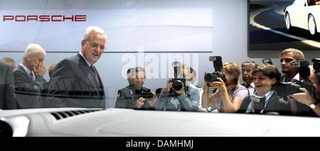 Chairman of the board of Porsche AG, Matthias Mueller (L), and the chairman of the board of Porsche Automobil Holding - Stock Photo