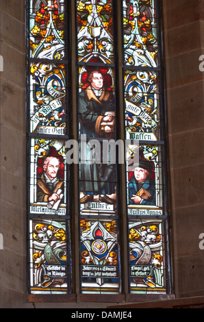 Koenigsberg in Bavaria St. Mary's church, stained glass window portraits of Martin Luther, Philipp Melanchthon and - Stock Photo