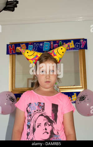 Young girl in bad mood at Birthday Party Funny . FULLY MODEL RELEASED - Stock Photo